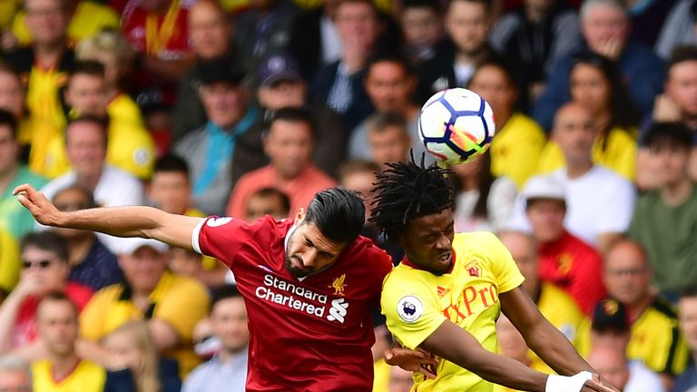 Emre Can and Nathaniel Chalobah battle for possession at Vicarage Road