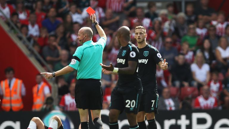 Marko Arnautovic looks on in disbelief as referee Lee Mason shows him a red card