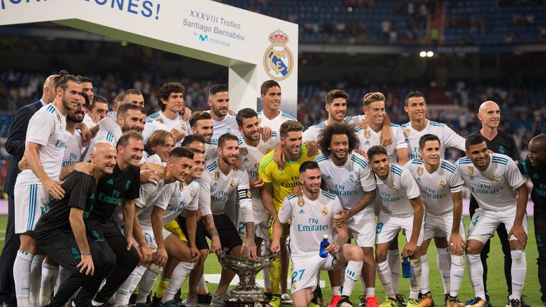 Real Madrid players celebrate with the Santiago Bernabeu trophy