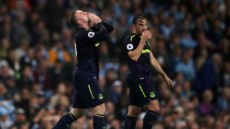 Everton's Wayne Rooney celebrates reaching 200 Premier League goals