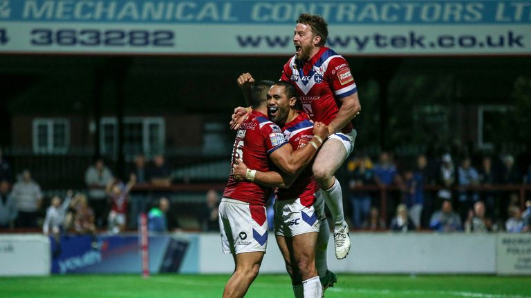 Bill Tupou is congratulated by Tinirau Arona and Danny Kirmond after scoring Wakefield's sixth try