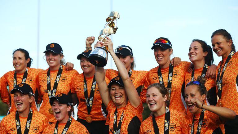 Charlotte Edwards holds the Kia Super League trophy aloft