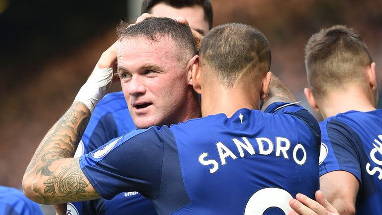 Wayne Rooney is congratulated by his team-mates after scoring