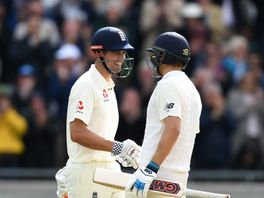 Cook is congratulated in the middle by Malan