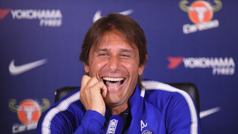 Antonio Conte of Chelsea laughs at a question about Diego Costa during a press conference at Chelsea Training Ground on August 18, 2017 in Cobham, England