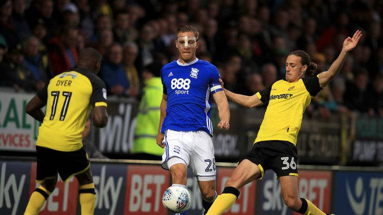 Birmingham City's Michael Morrison (centre) and Burton Albion's Jackson Irvine (right) battle for the ball during the Sky Bet Championship match at the Pir