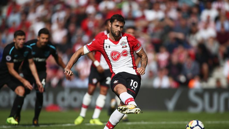 SOUTHAMPTON, ENGLAND - AUGUST 19: Charlie Austin of Southampton celebrates scoring his sides third goal from the penalty spot during the Premier League mat