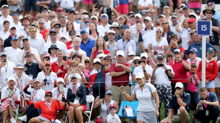 Cristie Kerr of the United States Team celebrates holing the match winning putt on the 15th hole