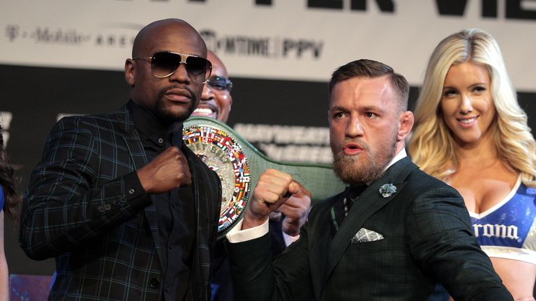 TOPSHOT - Boxer Floyd Mayweather Jr. (L) and MMA figher Connor Mcgregor pose during a media press conference August 23, 2017 at the MGM Grand in Las Vegas,