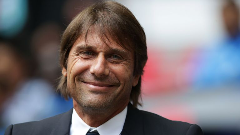 Antonio Conte is all smiles before the Premier League match between Tottenham Hotspur and Chelsea at Wembley Stadium