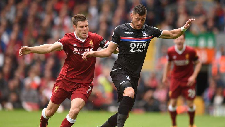James Milner (L) vies with Crystal Palace defender Joel Ward
