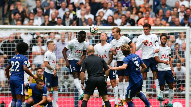 Chelsea's Marcos Alonso (R) curls a free kick over the Tottenham defensive wall to score the opening goal during the Premier League clash at Wembley