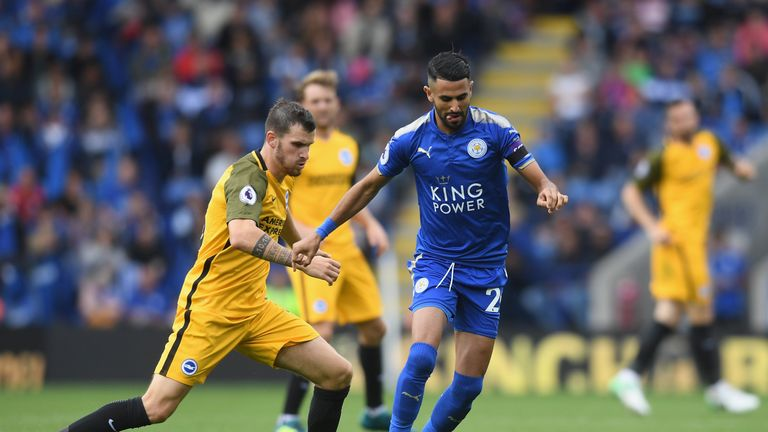 LEICESTER, ENGLAND - AUGUST 19: Riyad Mahrez of Leicester City and Pascal Grob of Brighton and Hove Albion  during the Premier League match between Leicest