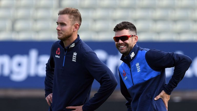 England's Stuart Broad (L) and England's James Anderson attend a training session on the eve of the first day of the first Test Match