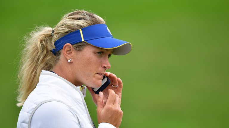 Suzann Pettersen of Team Europe talks on he phone during practice for The Solheim Cup at the Des Moines Country Club on
