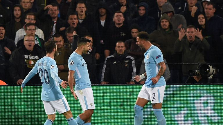 Sergio Aguero (centre) celebrates putting City 2-0 up