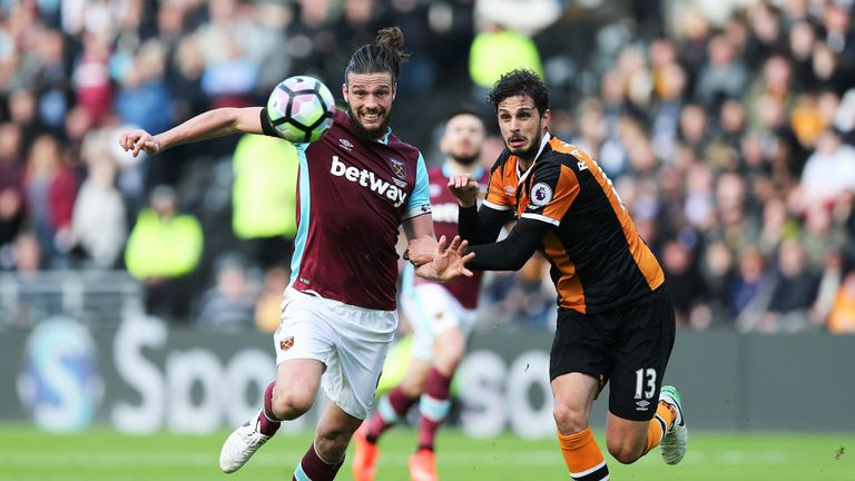 Slaven Bilic has hinted Andy Carroll must stay fit to earn new deal