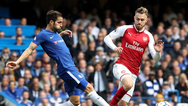 Cesc Fabregas and Ramsey battle for the ball