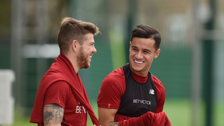Philippe Coutinho laughs with Alberto Moreno after returning to Liverpool training