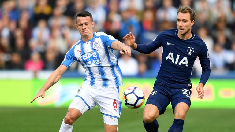 Jonathan Hogg of Huddersfield Town and Christian Eriksen of Tottenham Hotspur battle for possession