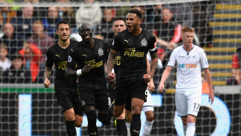 Jamaal Lascelles celebrates his winner at the Liberty Stadium