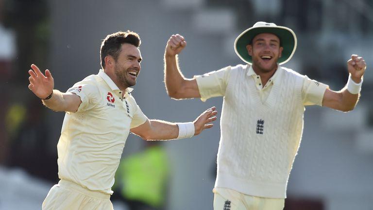 Stuart Broad (right) celebrates Anderson's 500th Test wicket