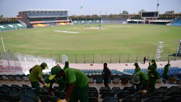 Staff at Gaddafi Stadium in Lahore prepare the venue for the three T20Is