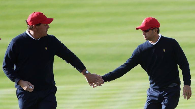 Phil Mickelson and Kevin Kisner defeated Emiliano Grillo and Jhonattan Vegas in Saturday's foursomes