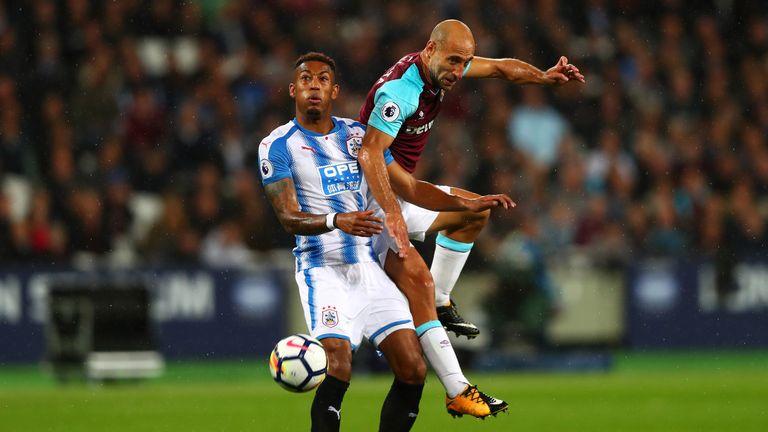 West Ham's Pablo Zabaleta and Rajiv van La Parra of Huddersfield battle for the ball