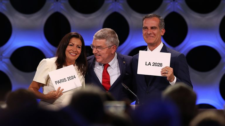 Paris mayor Anne Hidalgo, IOC president Thomas Bach and Los Angeles mayor Eric Garcetti react after confirmation of their successful bids