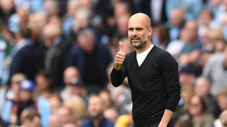 Manchester City's Spanish manager Pep Guardiola gives a thumbs up