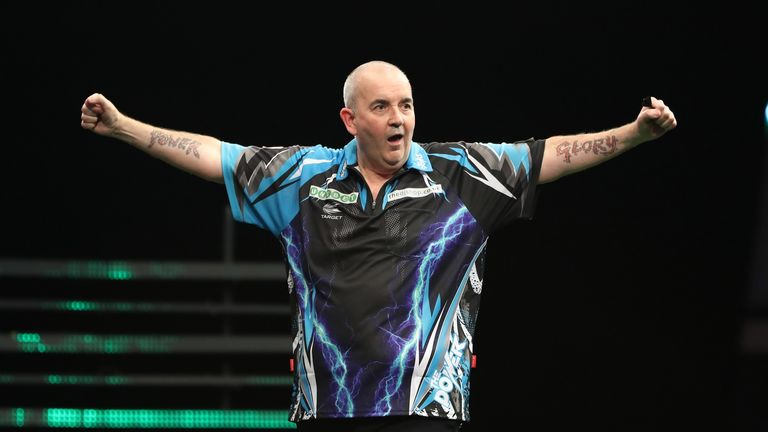 Phil Taylor is on the brink of the last four after maintaining his perfect record at the Champions League of Darts