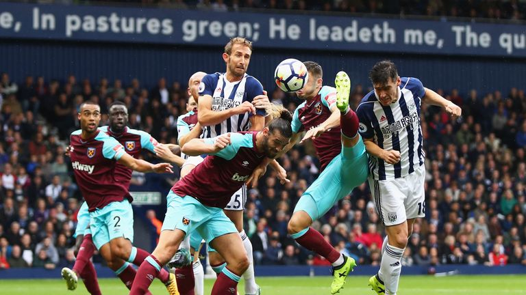 Barry (right) heads towards goal during the first half at The Hawthorns
