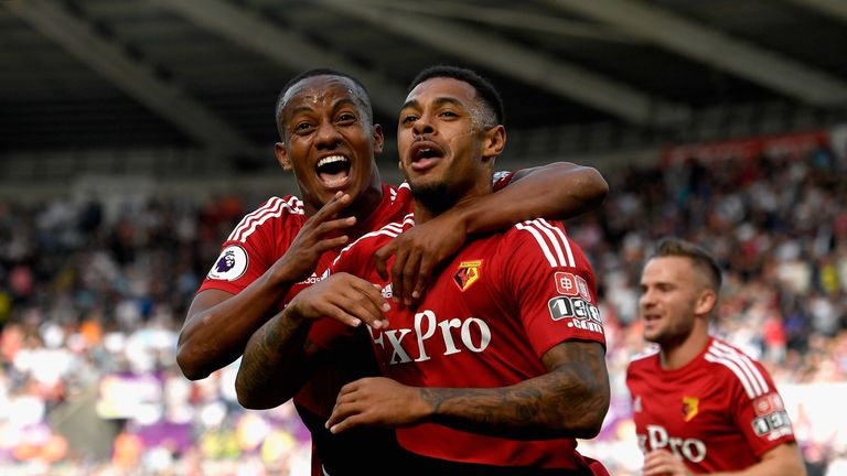 Andre Gray (R) celebrates his first Watford goal with team-mate Andre Carrilo (L)