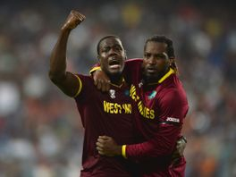 Carlos Brathwaite (L) and Chris Gayle after dismissing Joe Root