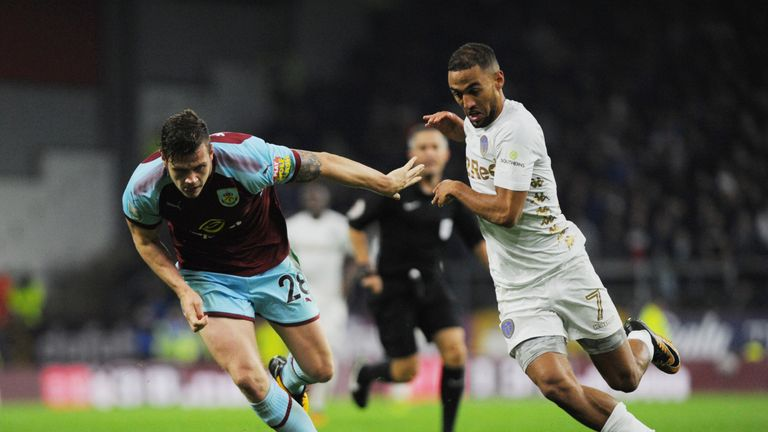 BURNLEY, ENGLAND - SEPTEMBER 19: Kemar Roofe of Leeds and Kevin Long of Burnley in action during the Carabao Cup Third Round match between Burnley and Leed