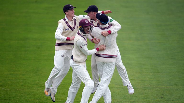 Dom Bess of Somerset (2R) celebrates after running out John Simpson of Middlesex