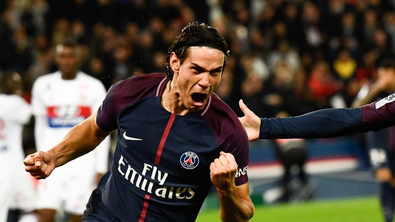 Edinson Cavani celebrates scoring the opening goal during the French Ligue 1 match between PSG and Lyon