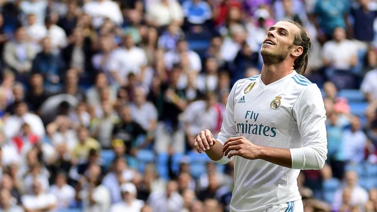 Real Madrid's Welsh forward Gareth Bale gestures after missing a goal during the Spanish Liga football match Real Madrid vs Levante at the Santiago Bernabe