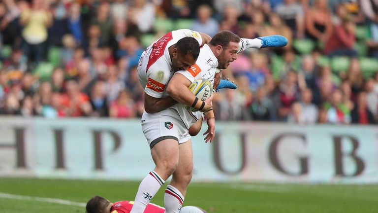 LONDON, ENGLAND - SEPTEMBER 23:  Greg Bateman of Leicester Tigers lifts Telusa Veainu of Leicester Tigers in the air as he celebrates scoring a try during