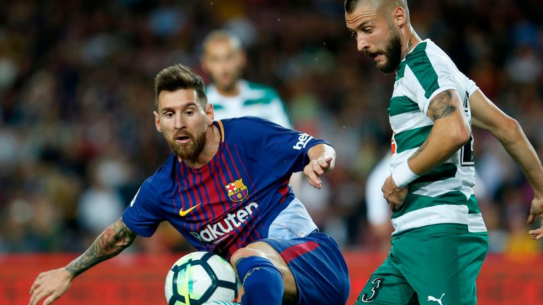 Lionel Messi (L) vies with David Junca during the Spanish league football match FC Barcelona v Eibar