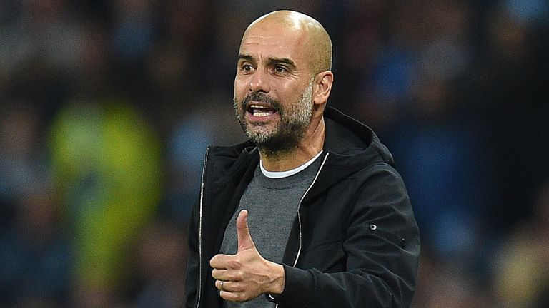 Manchester City's Spanish manager Pep Guardiola shouts instructions to his players from the touchline during the Group F football match between Manchester