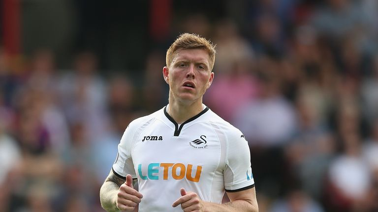 Alfie Mawson helped Swansea's 10 men hold Huddersfield to a draw