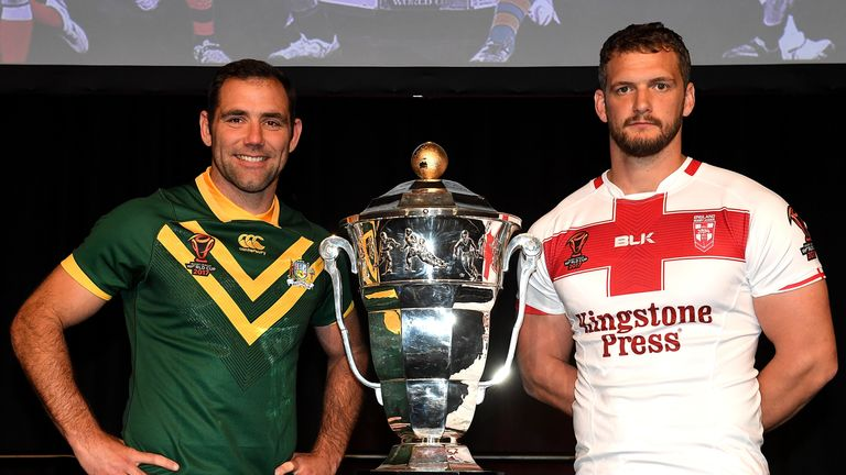 Cameron Smith and Sean O'Loughlin pose with the trophy