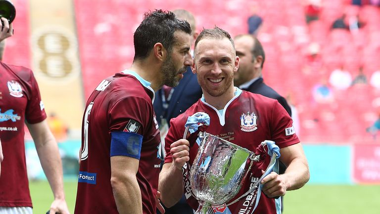 Arca and team-mate David Foley celebrate victory at the end of The Buildbase FA Vase Final between South Shields and Cleethorpes Town
