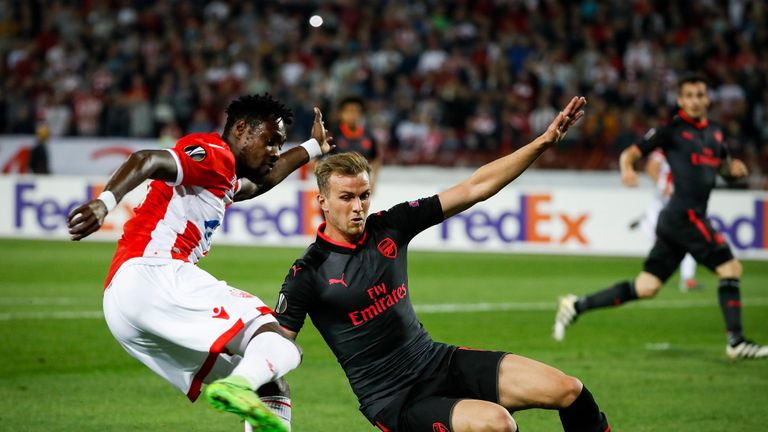 Rob Holding slides in on Richmond Boakye in the first half