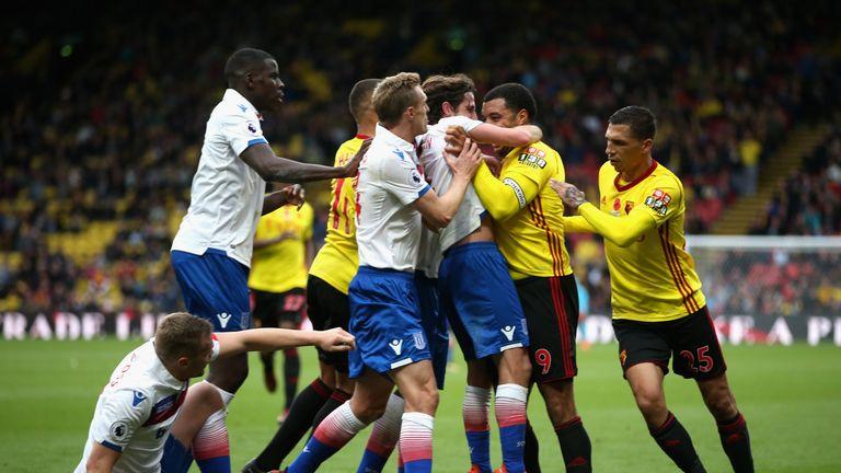 Joe Allen of Stoke City and Troy Deeney of Watford clash