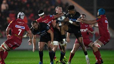 Bath fullback Anthony Watson (3rd r) contests a high ball during the Champions Cup match at Scarlets
