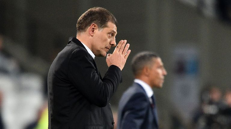 West Ham United's Croatian manager Slaven Bilic (L) and Brighton's Irish manager Chris Hughton watch from the touchline during the English Premier League f