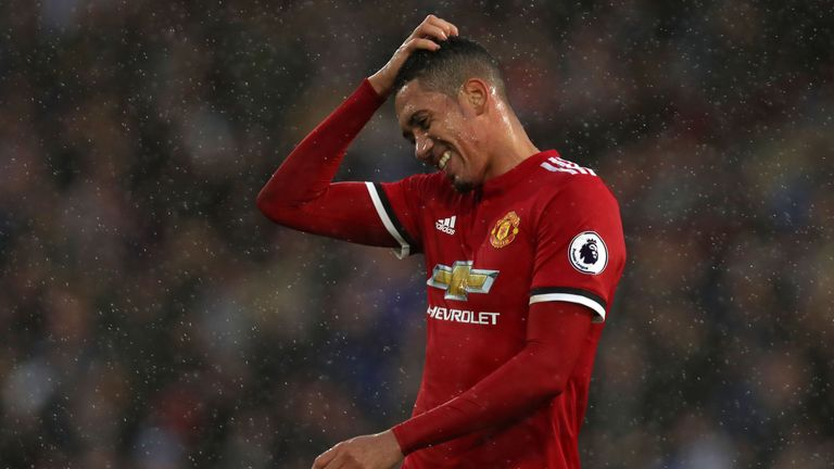 Manchester United's English defender Chris Smalling gestures during the English Premier League football match between Huddersfield Town and Manchester Unit